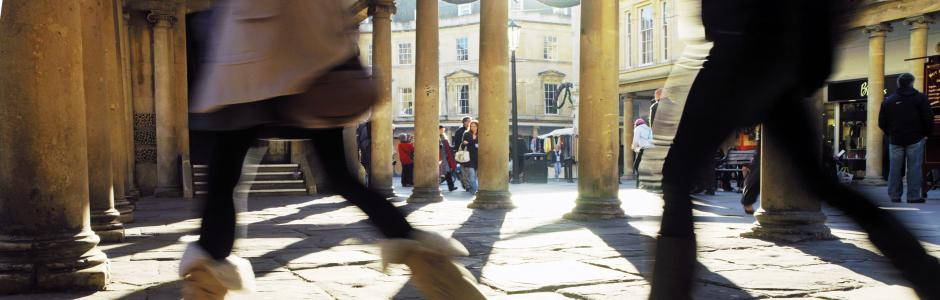 Ground level picture of workers walking down a Bath street