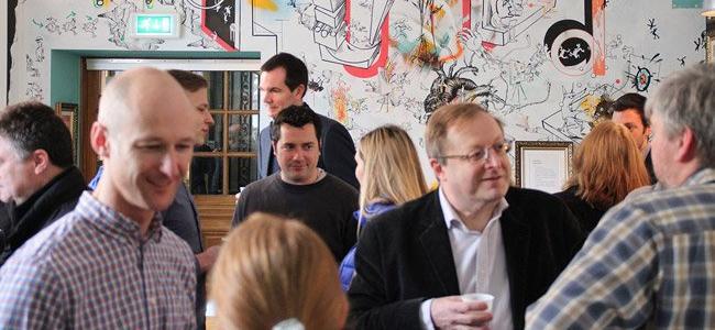 A bustling networking event for creative businesses